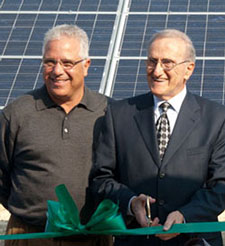 Joe and JM Procacci cutting the ribbon for Santa Sweets Solar Field